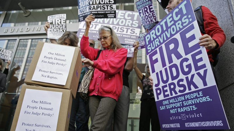 Activists from UltraViolet, a national women's advocacy organization, hold a rally before delivering over one million signatures to the California Commission on Judicial Performance calling for the removal of Judge Aaron Persky from the bench Friday, June 10, 2016, in San Francisco. Photo via AP.