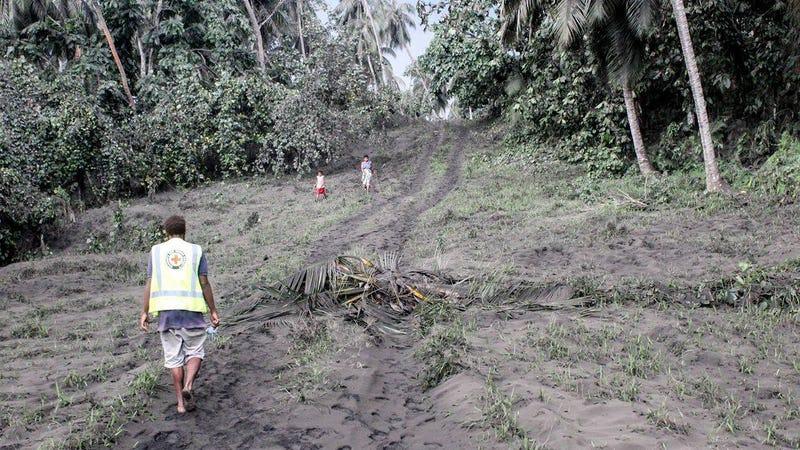 Vanuatu Red Cross personnel looking at ash fall in East Ambae.