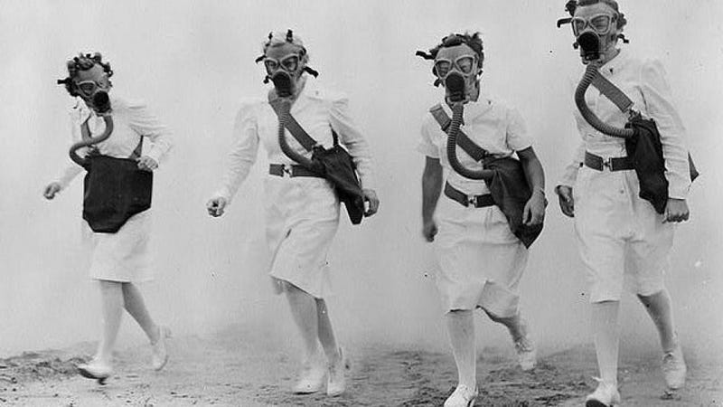 Illustration for article titled These WWII nurses in gas masks look like retro-futuristic superheroes