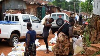 United Nations World Food Program staff during a supply-delivery operation in Freetown, Sierra Leone, on Nov. 7, 2014FRANCISCO LEONG/Getty Images