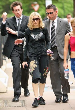 Illustration for article titled Madonna Ignores Fan's Attempt At Engagement; Obscene Gesture
