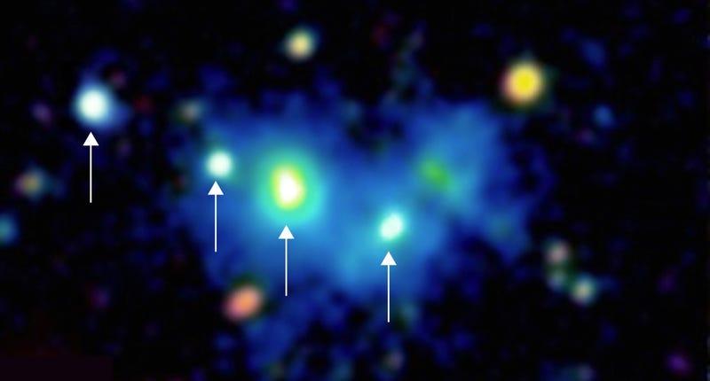 Illustration for article titled Astrónomos captan por 1ª vez una masiva estructura de 4 agujeros negros