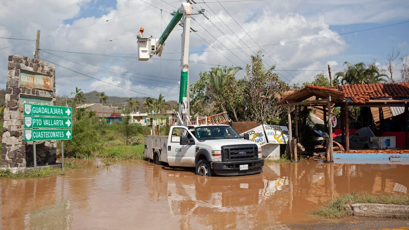 Men work to restore downed powerlines iafter damage from Hurricane Patricia October 24, 2015 in Melaque, Jalisco, Mexico.
