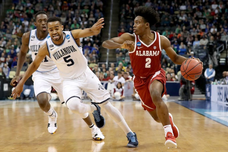 Collin Sexton, No. 2, of the Alabama Crimson Tide, dribbles against Phil Booth, No.5, of the Villanova Wildcats during the first half in the second round of the 2018 NCAA Men's Basketball Tournament at PPG Paints Arena on March 17, 2018, in Pittsburgh.