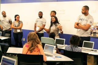 Google employees Jackson Georges, Torie Bates, Willie Lamar, Chris Clark, Larisse Voufo and James Goree teach children in Charleston, S.C., about computer science during the Black Googlers Network annual outreach trip in August 2015.Courtesy of Google