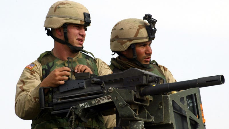 US forces man a mounted MK19 40mm grenade launcher in Afghanistan, 2003.