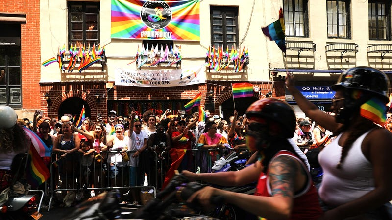 The New York Pride Parade rides past Stonewall inn
