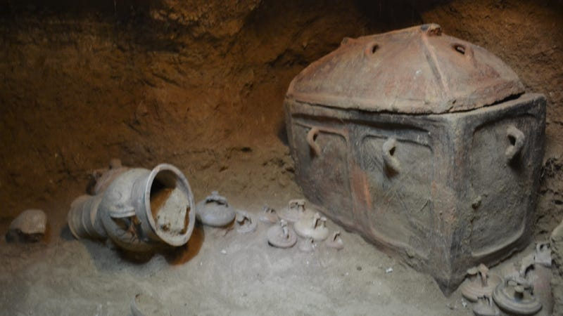One of two coffins found in the tomb, amid bits of pottery.