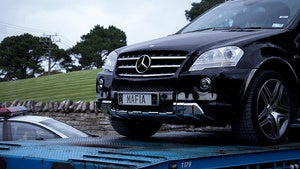 Illustration for article titled Here Are MegaUpload's Kim Schmitz's Cars Being Seized