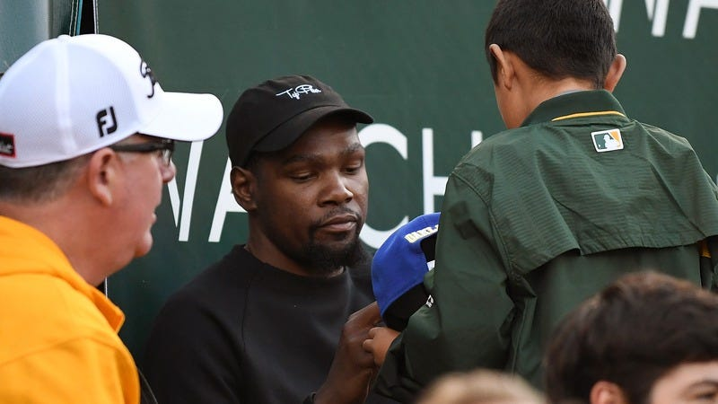 Here's an image of Kevin Durant signing autographs at an Oakland A's game, because restrictions on NBA wire images are no joke (Photo: Thearon W. Henderson/Getty Images)