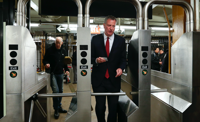 New York City Mayor Bill de Blasio enters the subway station Tuesday, March 22, 2016. (AP Photo/Frank Franklin II, Pool)