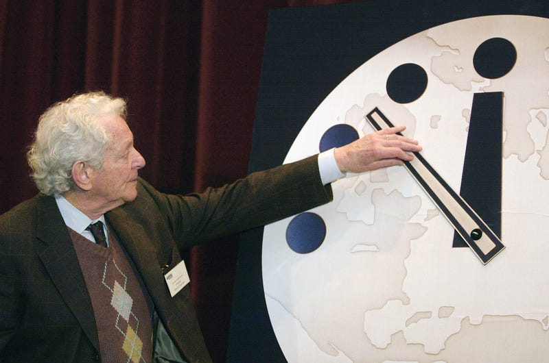 "Physics Nobel Prize winner Dr. Leon M. Lederman moves the hands of the Bulletin of the Atomic Scientists' ""Doomsday Clock"" two minutes closer to midnight on Feb. 27, 2002, at the University of Chicago. (Tim Boyle/Getty Images)"