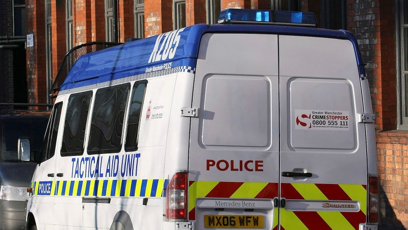 Police officers arrive at the Great John Street Hotel in the centre of Manchester were an alleged rape of a woman took place during the Manchester United Football Club's annual Christmas party.