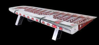 Illustration for article titled Table Made of DC-4 Wing Shall Be Mine