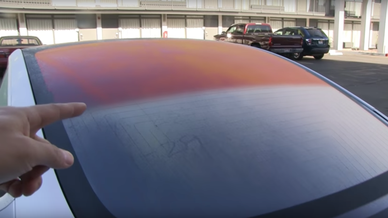 Illustration for article titled Here's Why the Glass Roof on the Tesla Model 3 Sometimes Looks Orange