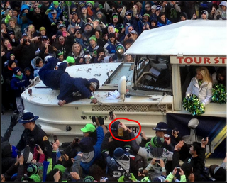 Illustration for article titled Marshawn Lynch Reaches For A Bottle Of Fireball At The Seahawks Parade