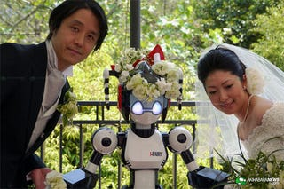 Illustration for article titled Couple Married By Robot, Can Death Ray Divorce Be Far Behind?