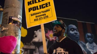 Residents protest in reaction to a mistrial declared in the trial of Police Officer William Porter in Baltimore on Dec. 16, 2015.MOLLY RILEY/AFP/Getty Images