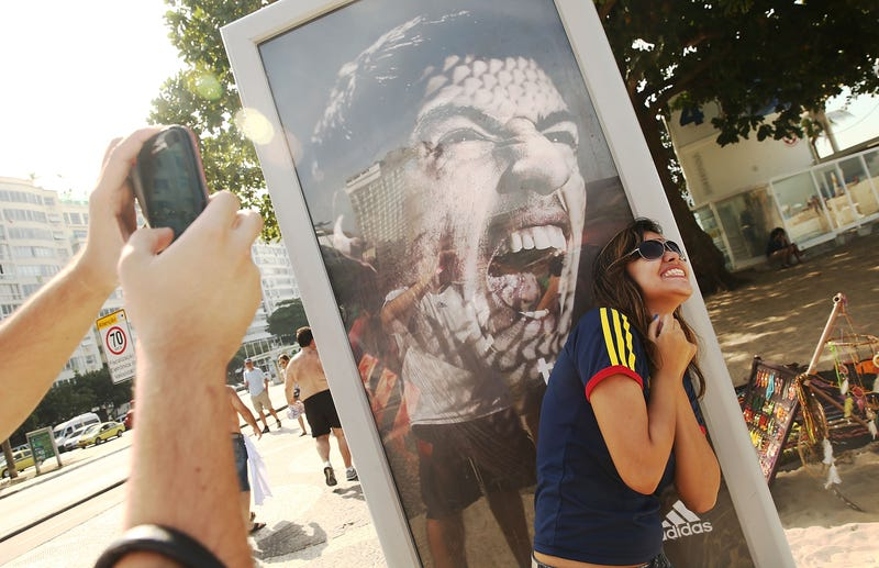 Illustration for article titled People In Rio Are Doing Funny Things With A Luis Suárez Billboard