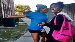 """""""Sharkeisha"""" is shown in a video hitting a girl later identified asShamichael Manuel.Screenshot from video"""