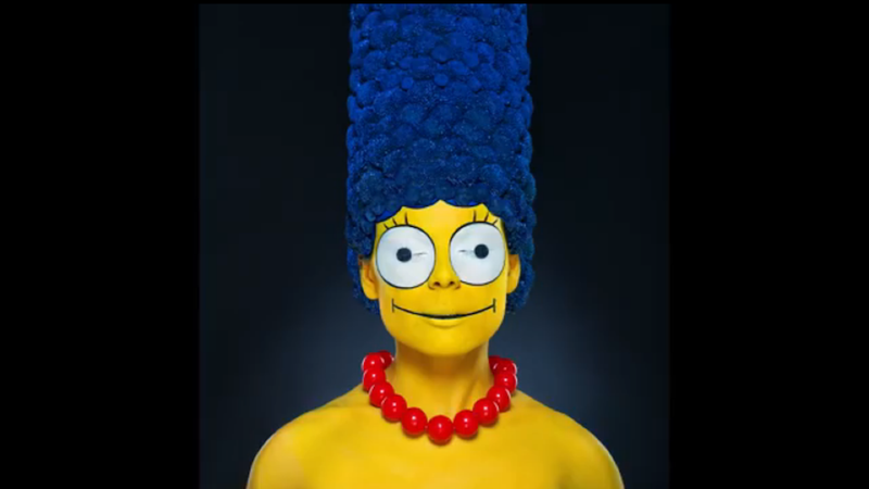 Illustration for article titled Watch This Model Transform Into Marge Simpson With Makeup and Flowers