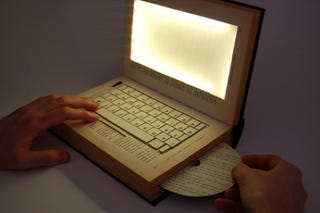 Illustration for article titled The Laptop Book Makes a Deep Statement, But No One Cares Because It's a PC in a Book!