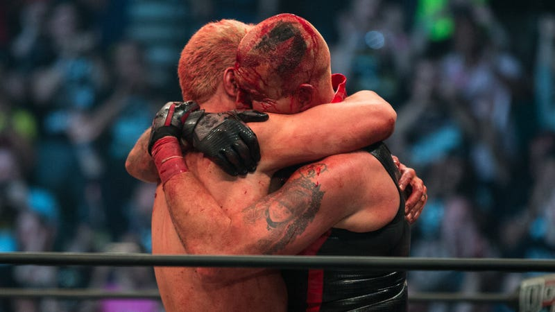 Cody Rhodes embraces his hemorrhaging brother, Dustin, after their show-stealing match at AEW's inaugural event, Double or Nothing.