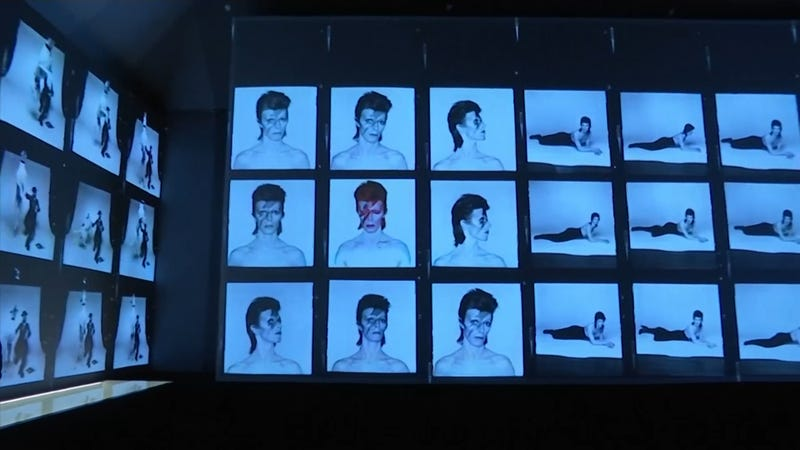 Photos of David Bowie line an exhibit dedicated to the late musician and icon.