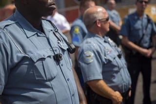 Members of the Ferguson Police Department wear body cameras during a rally Aug. 30, 2014, in Ferguson, Mo. Michael Brown, an 18-year-old unarmed teenager, was shot and killed by Officer Darren Wilson Aug. 9.Aaron P. Bernstein/Getty Images