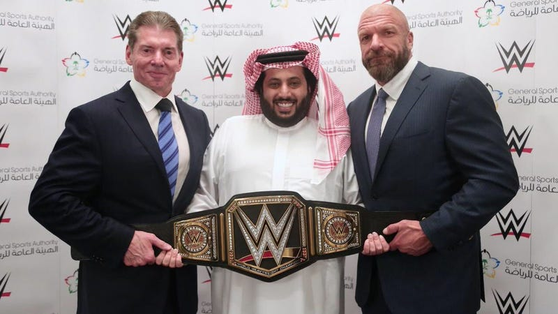 "Vince McMahon, Turki bin Abdel Muhsin Al-Asheik of Saudi Arabia's General Sports Authority, and Paul ""Triple H"" Levesque."