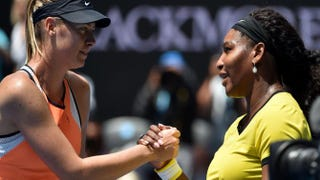 Serena Williams (right) shakes hands with Maria Sharapova after winning their women's singles match at the Australian Open in Melbourne Jan. 26, 2016.SAEED KHAN/AFP/Getty Images