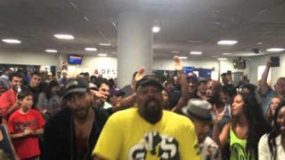Performance by casts of Lion King and Aladdin in LaGuardia Airport May 31, 3015, in New York CityYouTube screenshot