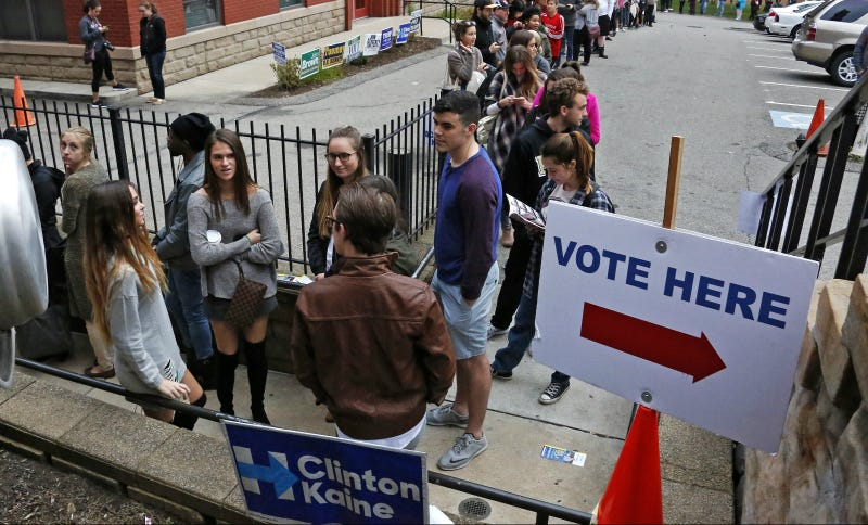Students from Duquesne University wait in line to cast their votes outside Epiphany Catholic Church in Pittsburgh, Tuesday, Nov. 8, 2016. Photo via AP