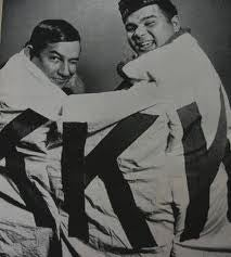 Sim and Charlie Warriax, two members of the Lumbee Nation, display a captured KKK banner.