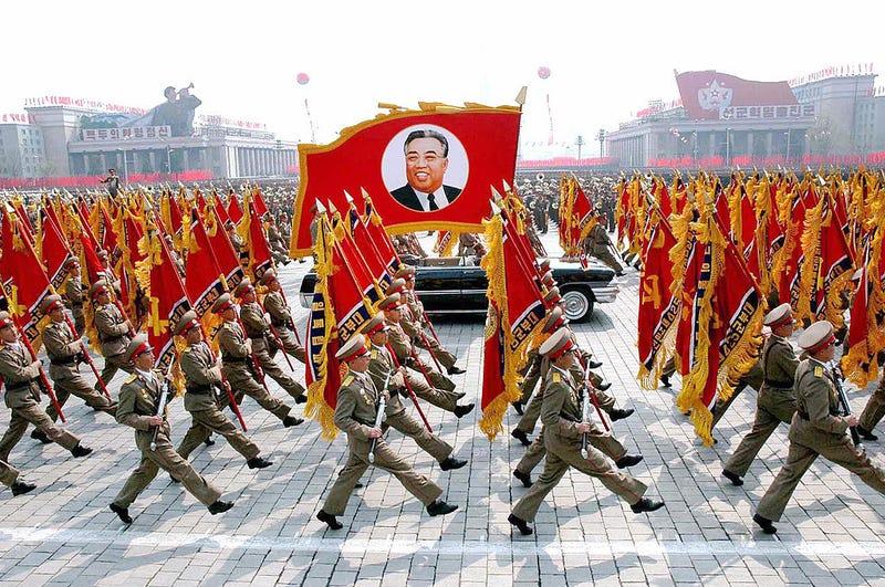 This April 25, 2007, picture, released from Korean Central News Agency, shows North Korean soldiers, carrying a large portrait of late North Korean leader Kim Il Sung, marching during a grand military parade to celebrate the 75th founding anniversary of the Korean People's Army at the Kim Il Sung square in Pyongyang, North Korea. (KCNA/AFP/Getty Images)