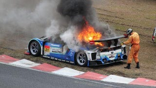 Illustration for article titled That's A Toyota Prius Race Car On Fire