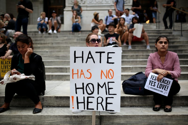 "A protester holds a banner reading ""Hate Has No Home Here"" during a rally in New York City on Aug. 14, 2017, against President Donald Trump for threatening North Korea and Venezuela with an attack. (Mohammed Elshamy/Anadolu Agency/Getty Images)"