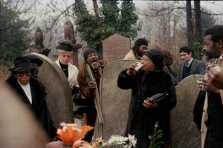 Drinking and hanging out by the graveside of Uncle Son's funeral as Baron Baker looks onCharlie Phillips