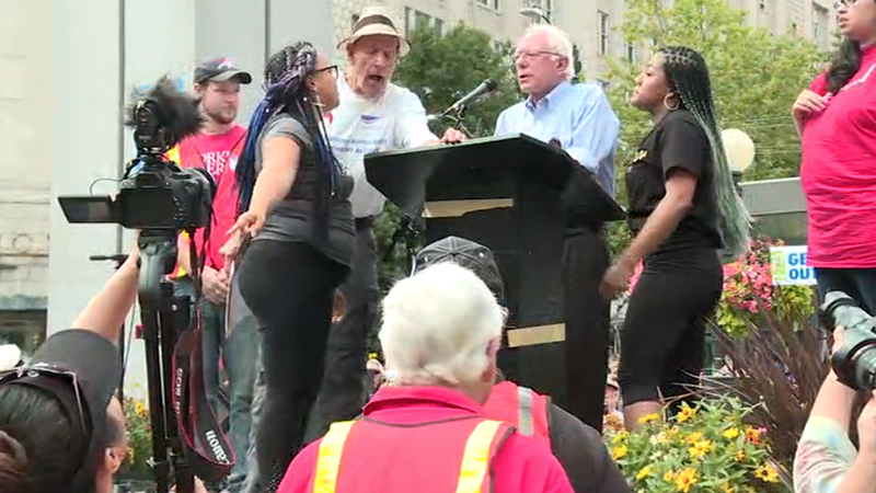 Marissa Johnson and Mara Willaford interrupt Bernie Sanders' rally in Seattle on Aug. 8, 2015.Getty Images