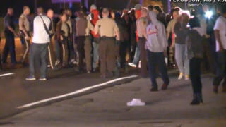 Protests flare up in Ferguson, Mo., Sept. 23, 2014, after a memorial to Michael Brown, the unarmed teen killed by police there, is burned. KDSK-TV Screenshot