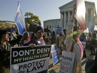 Health care law supporters outside the Supreme Court (Enlarge Charles Dharapak/AP)