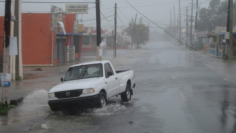 A car drives in Fajardo, Puerto Rico as Hurricane Irma passes to the north on September 6th. Photo: AP
