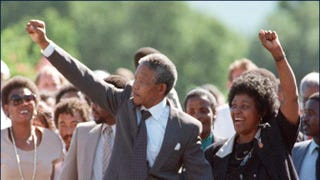 African National Congress leader Nelson Mandela and wife, Winnie, raise fists upon his release from Victor Verster Prison Feb. 11, 1990, in Paarl, South Africa.ALEXANDER JOE/AFP/Getty Images