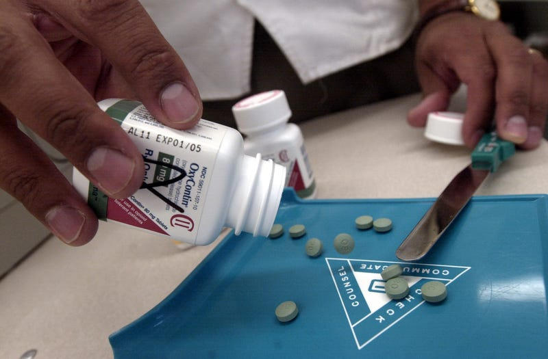 The prescription medicine OxyContin is displayed Aug. 21, 2001, at a Walgreens drugstore in Brookline, Mass. The powerful painkiller, manufactured to relieve the pain of seriously ill people, is being used by some addicts to achieve a high similar to a heroin rush. (Darren McCollester/Getty Images)