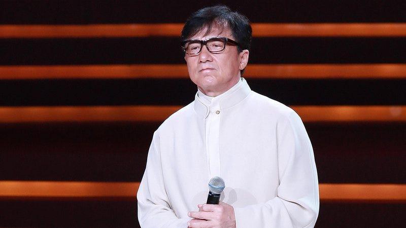 Jackie Chan looking solemn.