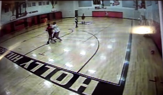 Travis Mims and Katherine Martin (foreground) while playing a pickup-basketball game, caught on surveillance footage inside a Florida high school gym Feb. 17, 2015YouTube screenshot