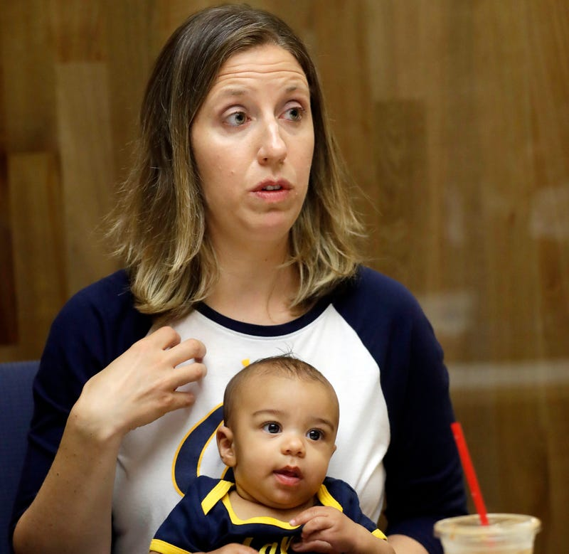 In an Aug. 30, 2017, photo, California women's basketball coach Lindsay Gottlieb holds her then-6-month-old son, Jordan, during NCAA college basketball practice on the campus.