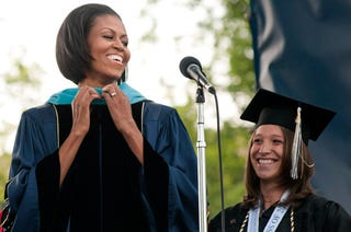 Illustration for article titled Michelle Obama Makes Even A Graduation Robe Look Good