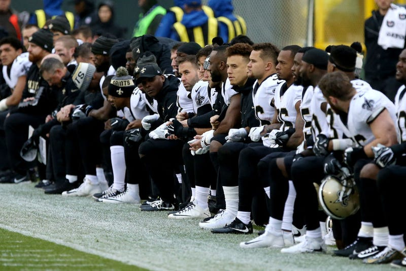 The New Orleans Saints kneel before the playing of the national anthem ahead of the game against the Green Bay Packers at Lambeau Field in Green Bay, Wis., on Oct. 22, 2017. (Dylan Buell/Getty Images)