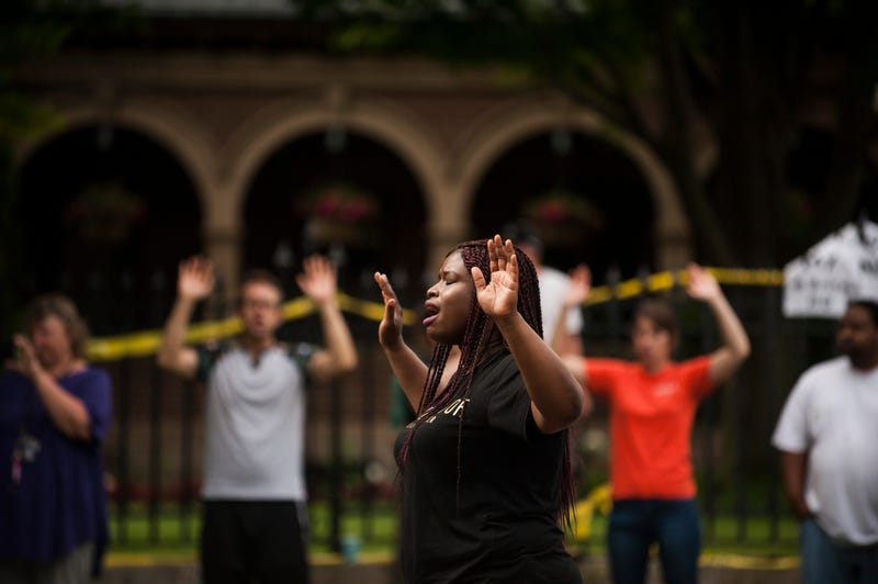 "Minneapolis NAACP President Nekima Levy-Pounds leads a chant of ""Hands up, don't shoot"" for Philando Castile outside Minnesota governor's mansion July 7, 2016, in St. Paul, Minn. Castile was shot and killed by police July 6, 2016, in Falcon Heights, Minn.Stephen Maturen/Getty Images"